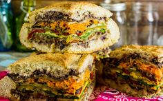 A muffuletta is a sandwich that has origins among Italian immigrants in New Orleans. This version eschews the meats and cheese and is all veggie, baby! Veggie Sandwich, Vegan Sandwiches, Muffuletta Sandwich, Muffuletta Recipe, New Orleans, Vegetarian Recipes, Healthy Recipes, Healthy Meals, Vegetarian Lifestyle