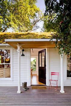 farmhouse porch by Jessica Helgerson Interior Design  Not only does this adorable farmhouse make it super tempting to build our own tiny minimalist home, but the design elements are so beautiful and rustic. I am pinning all of these shots for inspiration for my future home, even its its not quite THIS small. LOVE!!