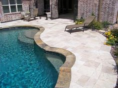 gold travertine pool deck with french pattern | outdoor living