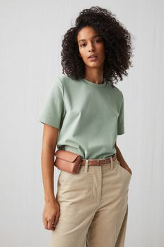 A regular-fit T-shirt in a dense interlock quality that gives the fabric a smooth and lustrous feel. Wide piping at neck. Green Top Outfit, Mint Green Outfits, Mint Green Shirts, Mint Green Tops, Mint Shirt Outfits, Aesthetic Shirts, Short Tops, Pretty Outfits, Girly Outfits