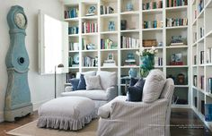 Bookcases - to the ceiling and wall-to-wall.