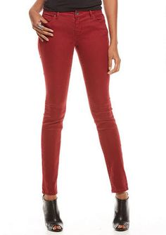Super-stretch lightweight low-rise skinny jean with back patch pockets.