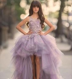 Lavender Long Trail Gown---15% Off----Flower Appliques Lavender Sleeveless Tiered Layered High Low Long Trail Flower Girl Gown Perfect for Birthday, Wedding, First Communion, Christening or any special day. Available from 2 until 14 years old  Material: Tulle, lace, cotton, organza Before checkout, you may leave a note about the desired color of the dress & your little girl measurements as details below if her size is not listed in our size guide: 1. Bust: ____cm/inches 2. Waist…