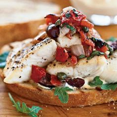Those who love the bold Mediterranean flavors of puttanesca sauce and grilled fish will love this hearty open-faced sandwich featuring grilled bread topped with peppery arugula, halibut, and a garlicky tomato salsa strewn with bits of olives and capers.