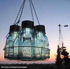 Solar Mason Jar Chandelier, Mason Jar Hanging Chandelier, Candles Garden Country Barn Rustic Wedding Original Mason Jar Solar Light Design. $140.00, via Etsy.