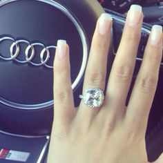 This is going to be me!! Audi and my ring (don't forget the cute nails) YES!!  Cushion cut with halo engagement ring