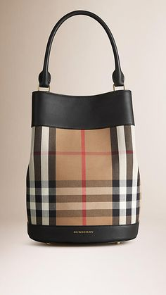 Burberry Black The Bucket Bag in House Check and Leather - The Bucket Bag in House check cotton and leather. Inspired by the runway, the design is made in Italy with hand-finished details. A detachable matching wristlet features inside. Discover the women's bags collection at Burberry.com