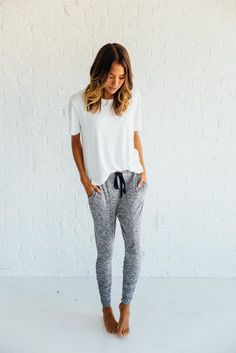 DETAILS: Peppered knit, 2 pocket, jogger pants with drawstring 51% rayon, 24% poly, 22% nylon, 3% spandex Runs small Model...