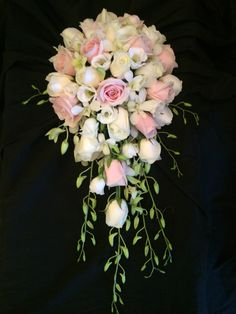 Shower bouquet of sweet Avalanche roses Ivory Avalanche roses and Singapore orchid White lizz cascading down