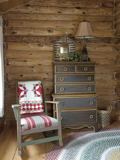 A rag rug, rocking chair, and dresser, all from the 1950s, share a corner of a guest room.