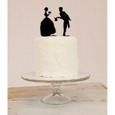 Personalized Silhouette Wedding Cake Topper in Acrylic made from your photos by Simply Silhouettes. $50.00, via Etsy.