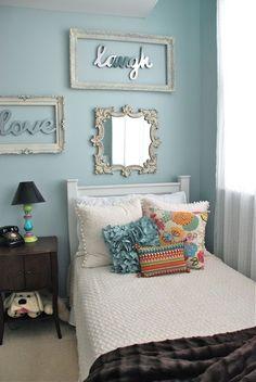 Cute Bedroom.  I love the framed mirror words.