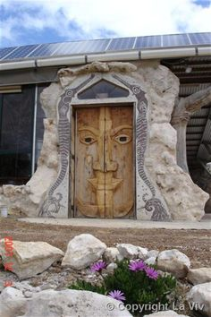 Face carved in wooden doors