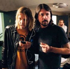 Just a pair of girlfriends sharing an iPod. Dave grohl and Taylor Hawkins forever. ❤️