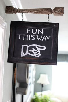 This would be halarious and awkward if this was pointing to your bedroom. Imagine your teens friends faces and your guests! Awkward. Hahahahaha! chalk board sign with old spindle - love! Joannas Home | The Magnolia Mom