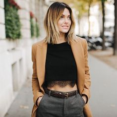 Caroline Receveur style - camel coat and a black crop top. I love the association with the trousers !