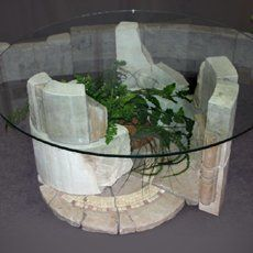 Roman forum coffee table made of stone in the ruins of style. 1200h1200h600. Moscow 2006. Decorative shapes - Sergey Karlov