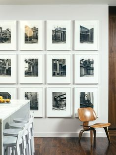 gallery wall with black and white photos.