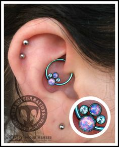 Fresh daith pierced by Darren with an implant grade titanium captive bead with a gorgeous anatometal cluster bead. Those opals are mesmerizing!