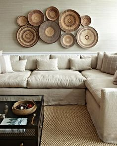 A beautiful collection of Zimbabwe Binga baskets grouped close together add to the natural beauty of this living room while adding visual interest with the variety of tones and basket heights. Choose your Binga collection at BasketsOfAfrica.com!
