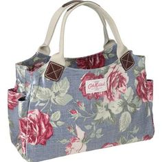 This practical design in our classic Antique Rose print is a popular choice of bag for everyday essentials. The durable oilcloth finish makes it easy to wipe clean and it is completed with cotton webbing handles and leather trim. Other handy features include a main zip fastening and internal zipped pocket, so you can be sure your belongings are kept safe. And just to finish it off - there are two handy side pockets - great for housing your brollie or a bottle of water!