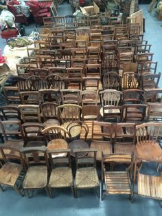 Various styles of old wooden rustic chairs