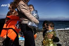 Aris Messinis  2 Οκτ Refugees and migrants at the Greek island of Lesbos.