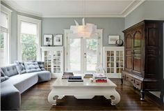 love the blue white and natural wood>  that coffee table - wow!