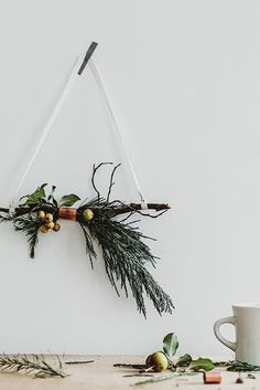 16 Modern Christmas Decorating Ideas - This simple, chic modern holiday decor makes for an easy DIY project. Gather your favorite greenery - Christmas Swags, Noel Christmas, Homemade Christmas, All Things Christmas, Christmas Crafts, Christmas Ornaments, Christmas Quilting, Purple Christmas, Christmas Tables