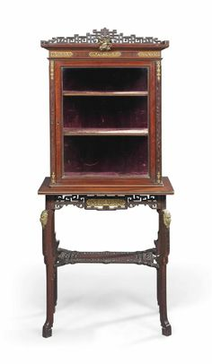 A FRENCH BRASS-MOUNTED MAHOGANY 'JAPONISME' CABINET-ON-STAND -  IN THE MANNER OF GABRIEL VIARDOT, LAST QUARTER 19TH CENTURY