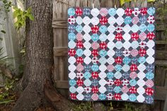 """Lella Boutique: You basically need a bunch of colorful 5"""" squares and lots of neutral 2"""" squares. To be more specific, I used eight colorful fat quarters and cut twelve 5"""" squares from each."""