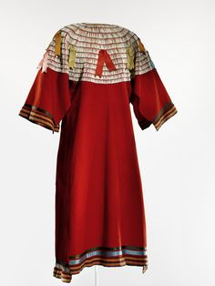 Woman's dress, probably Northern Tsitsistas/Suhtai (Cheyenne) (attributed); probably collected among the Nimi'ipuu (Nez Perce), 1890-1915, Wool cloth, dentalium shell/shells, ribbon, thread. Sewn