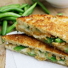 "Our ""Green Bean Casserole"" grilled cheese combines Camembert cheese with green beans, mushrooms, and french-fried onions."