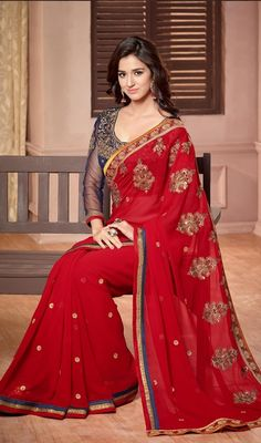 Hangout with friends in this red color embroidered georgette sari. The ethnic butta, crystals, stones, lace, resham and sequins work over a attire adds a sign of elegance statement for the look. Upon request we can make round front/back neck and short 6 inches sleeves regular saree blouse also. #CherryRedJardosiEmbroideredSari
