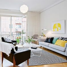 Living room inspiration: Loving the Black/White/Gray base with all the pops of color.