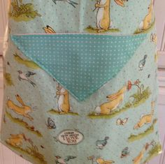 Easter child's full apron, bunny, blue bird, butter yellow ribbon, reversible, aqua dot by Littlebirdproductset on Etsy
