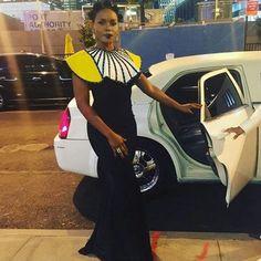 Yemi Alade on black gown and cape neck ~African fashion, Ankara, kitenge, African women dresses, African prints, Braids, Nigerian wedding, Ghanaian fashion, African wedding ~DKK