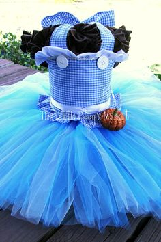 Girls Dorothy Wizard of Oz Tutu and Corset Halloween Costume- I don't have a girl but if I did, this would be her Halloween costume! So cute!