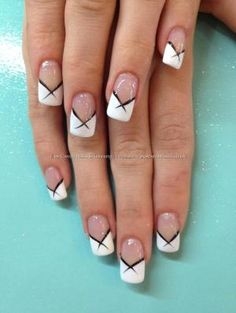 White French tips with black flick nail art.