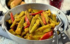 <p>Fresh okra, bell pepper, and red onion are tossed with mustard, olive oil, smoked paprika, and turmeric then baked until tender-crisp.</p>