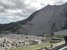 Frank's Slide, British Columbia, Canada. This was a very sad natural disaster. Half of the mountain exploded with built up gases and came roaring down on the town of Frank beneath it. The giant boulders have been left to mark the site and remind people of what happened and the main road drives right through the boulders.