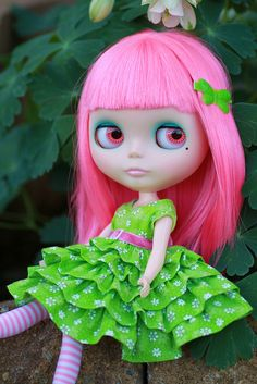 enjoying the outdoors in her new dress by queenbee2zz, via Flickr! Nice pink and green