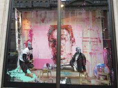 The Harvey Nichols windows on Sloane Street, London, showcase the work of artist Andrew Salgado. Each window sets the scene of an artist's studio, with giant portraits covering the back wall and props such as easels and tins of paint scattering the floor. Thick strokes of paint cover the mannequins' faces, which are dressed in SS'13 menswear fashions.