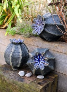 Free standing seed heads with blue glass. sucloudceramics.com
