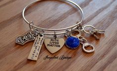 This Blue Lives Matter Bracelet is a silver plated, adjustable bangle that is made from lead free zinc alloy.  This is a Beautiful way to show support of our Law Enforcement who risk their lives every day, to keep our communities safe.  Bracelet ...