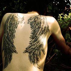 Angel wings inked on back...