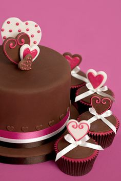 Chocolate Love £125 A Valentines gift or a present for the one you love? A mouth-watering chocolate cake with pink love heart detail. Cupcakes are £5-00 each to match.