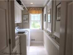 Beautiful Laundry Room - note the rod for hanging wet clothes to dry.