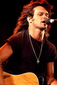 John Cougar Mellencamp Love his music and he was not bad to look at back in the day with his long hair.  I love long hair, but my Dad would have killed me if I had brought a guy home with hair that long.