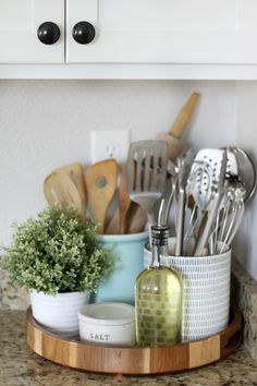 Home Decoration Kitchen style and clean kitchen countertops wooden serving tray with salt container oil and cooking utensils.Home Decoration Kitchen style and clean kitchen countertops wooden serving tray with salt container oil and cooking utensils Kitchen Countertop Decor, Home Decor Kitchen, Home Kitchens, Kitchen Ideas, Kitchen Cabinets, Kitchen Decor Themes, Decor For Small Kitchen, Organize Kitchen Utensils, Kitchen Remodeling